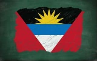 Antigua and Barbuda flag painted with color chalk on old blackboard