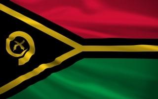Bandera de Vanuatu flameando en el cielo