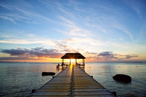 Jetty silhouette against beautiful sunset in Mauritius Island